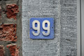 House number ninety nine sign Stock Photos