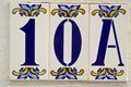 House number spanish style made up from ceramic tiles Stock Photo