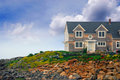 House on ocean shore Royalty Free Stock Photography
