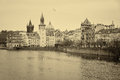 House of old prague and vltava river czech republic february sepia stylized film large grains Royalty Free Stock Image