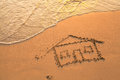 House painted on beach sand Royalty Free Stock Photography