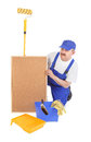 House painter and empty corkboard over white background Stock Photography