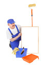 House painter and hollow frame over white background Royalty Free Stock Images