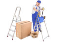 House painter ladders and cardboard boxes over white background Stock Photography