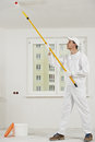 House painter at work with painting roller Royalty Free Stock Photo