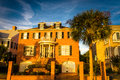 House and palm tree along Murray Drive in Charleston, South Caro Royalty Free Stock Photo