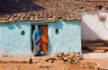 House of poor family and indian woman standing at the door Royalty Free Stock Photo