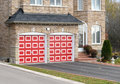 House with red garage doors Stock Photos