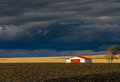 image photo : The barn with red roof under storm clouds