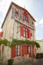 House with red shutter in old village in france Royalty Free Stock Photo