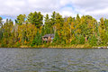 House on a remote lake in the fall Stock Photo