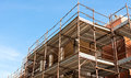 House for renovation with the scaffolding for bricklayers Royalty Free Stock Photo
