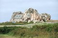 House between rock formation traditional breton some rocks at the pink granite coast on brittany france Stock Images
