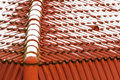 House roof ceramic tiles made of red with little snow Stock Image