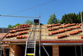 House roof construction a under with stacks of tiles Royalty Free Stock Image