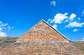 House roof and gable detail of the tiled red brick of an old against a blue sky shropshire england uk Stock Photography