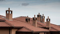 House rooftops with chimneys Royalty Free Stock Photo