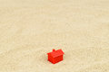 House on sand a single red sits an expanse of a market metaphor Stock Images