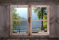 House on the sea in the alps - old rustic wooden window. Royalty Free Stock Photo