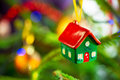 House shape bauble on christmas tree hanging Royalty Free Stock Photography