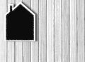 House shaped chalkboard over white wooden Royalty Free Stock Photo