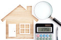 House shaped paper cutout, calculator, magnifier and pen on natu Royalty Free Stock Photo