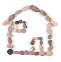 House shaped sign pebble stones isolated on white Royalty Free Stock Photography