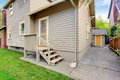 House with small deck and concrete walkways backyard view Royalty Free Stock Images