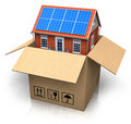 House with solar batteries in cardboard box Royalty Free Stock Photography