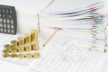 House and step gold coins with pencil put in paperwork Royalty Free Stock Photo