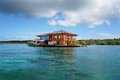 House on stilts over water of the Caribbean sea Stock Image