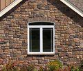 House Stone Wall with Window Royalty Free Stock Photos