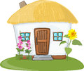 House with thatched roof white and flowers Stock Image