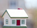 House toy on a blurred background in the solar day Royalty Free Stock Images
