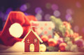 House toy and Christmas lights Royalty Free Stock Photo