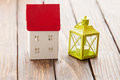 House toy and decorate lam on wooden table Royalty Free Stock Photo