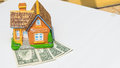 House toy on money bank notes Royalty Free Stock Photo