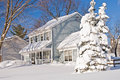 House and tree after snowstorm Royalty Free Stock Photo