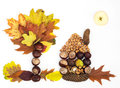 House tree and sun – autumn theme made of leaves apple chestnuts pine cones nuts on a white background Royalty Free Stock Images