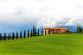 House with trees in Tuscany landscape, Italy Royalty Free Stock Photo