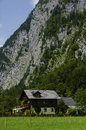 House under the alps cliff mountains Stock Photography