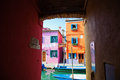 House underpass with view on colorful houses Stock Image