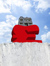 House weighing down british pound symbol on edge of cliff Stock Images