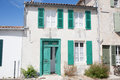 House white and green, in the old village in France. Royalty Free Stock Photo