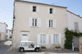 House with white shutter in old village in france Royalty Free Stock Photo