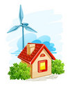 House with wind turbine for energy generation Stock Photos