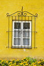 House window with a decorative protective grating. Royalty Free Stock Photos