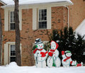House in winter and Snowman Family Royalty Free Stock Photography