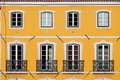House with yellow facade traditional and tall windows balconets in lisbon portugal Royalty Free Stock Images