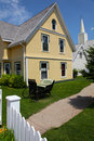House with Yellow Siding Stock Images